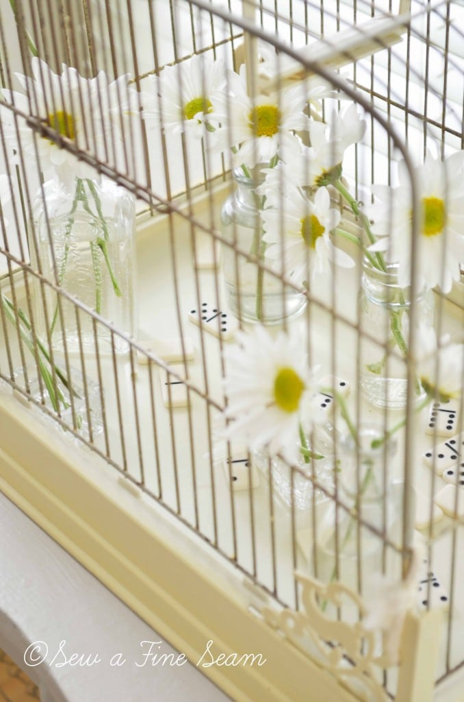 bird cage with daisys