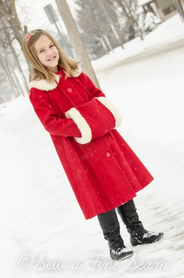red coat in the snow-10