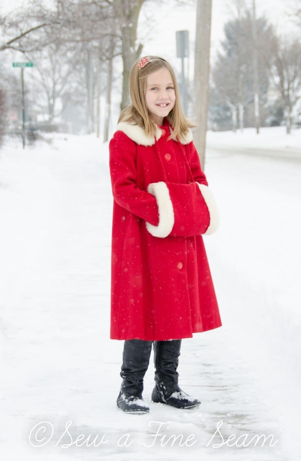 red coat in the snow-11