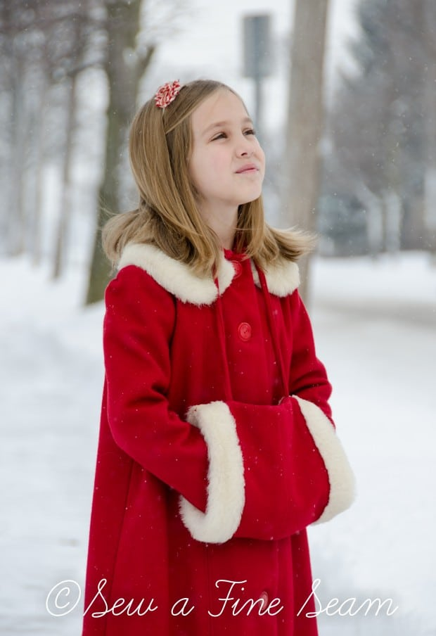 red coat in the snow-12