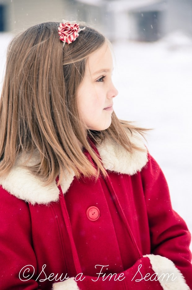 red coat in the snow-16