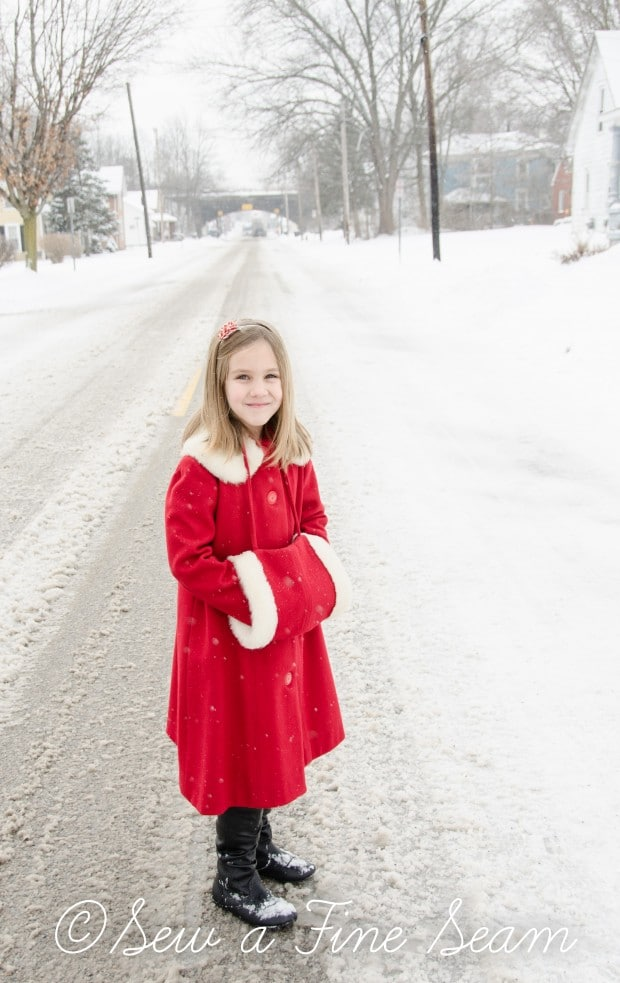 red coat in the snow-17