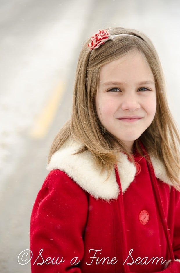 red coat in the snow-19