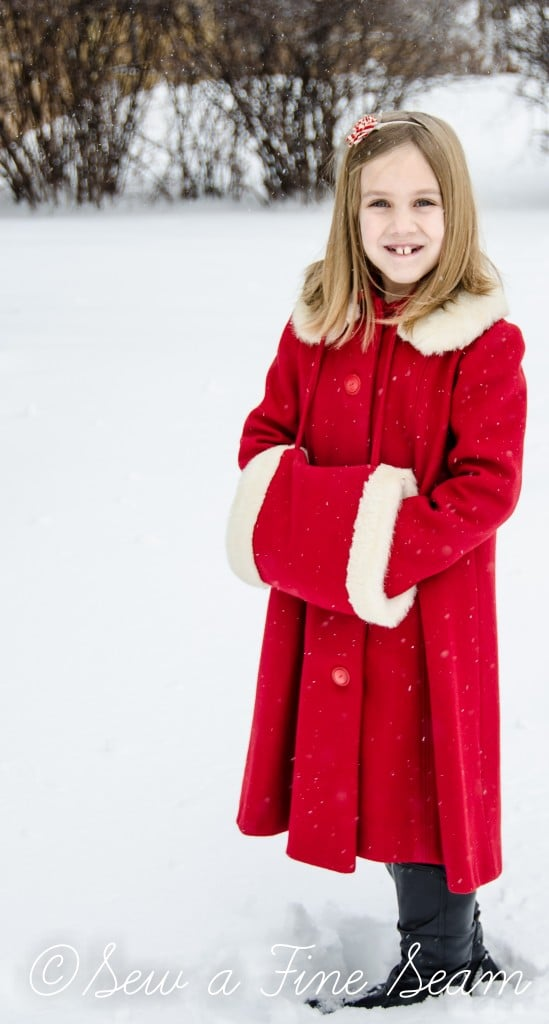 red coat in the snow-4