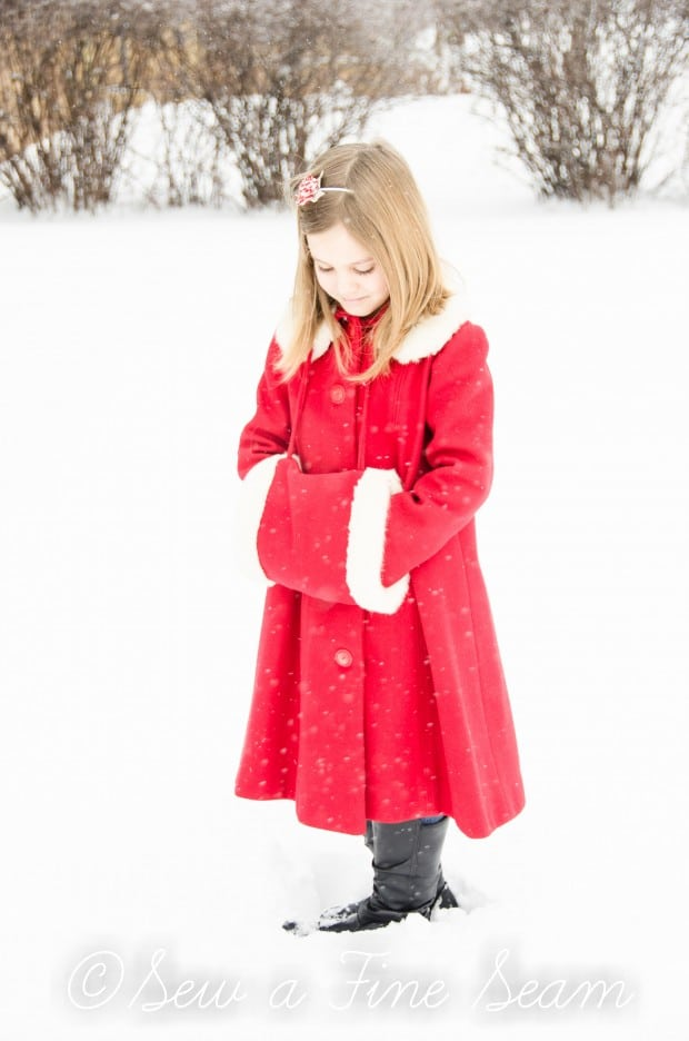 red coat in the snow-5
