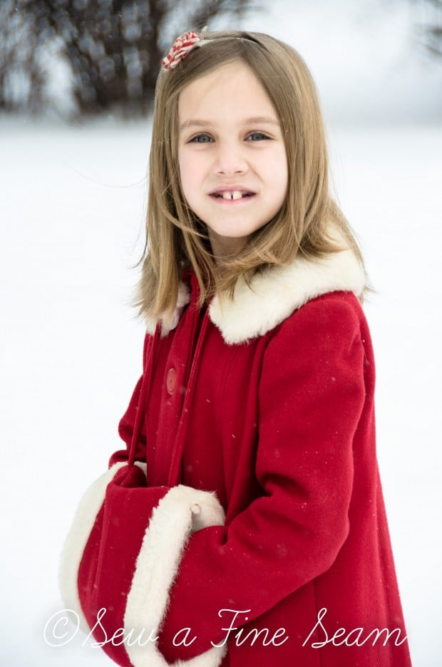red coat in the snow-8