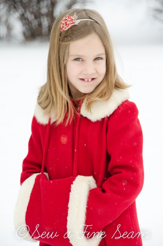 red coat in the snow-9