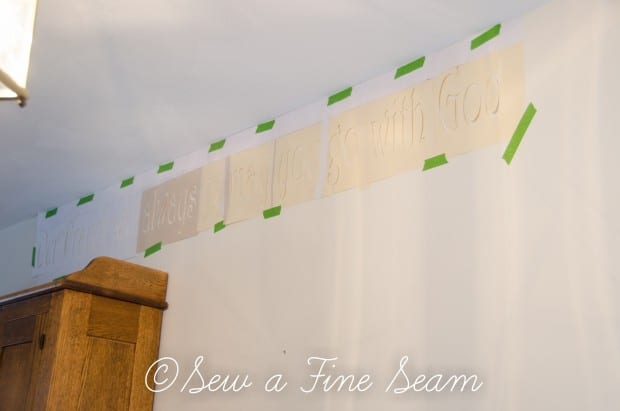 stenciling words on a wall-5