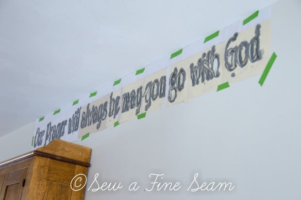 stenciling words on a wall-7