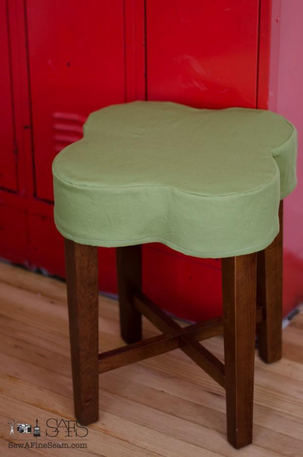 flower shaped ottoman slipcovered green