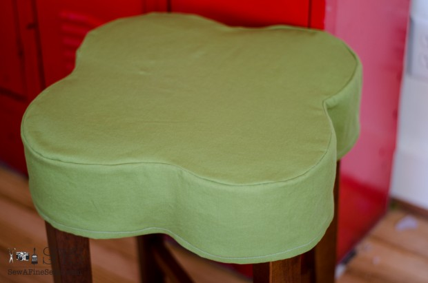 flower shaped ottoman slipcovered green top close up