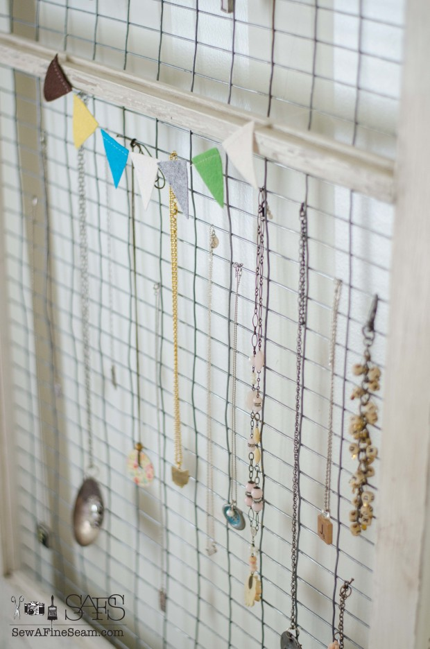 jewelry display for events and sales made with an old window and fencing