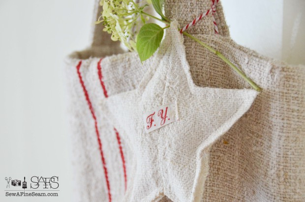 European grain sack made into star christmas ornaments.