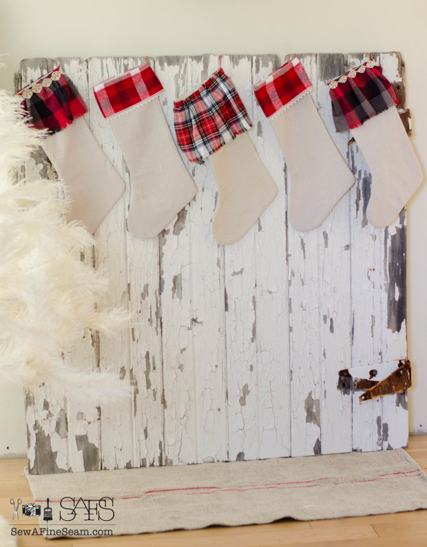 hang stockings on an old barn door when you don't have a mantel