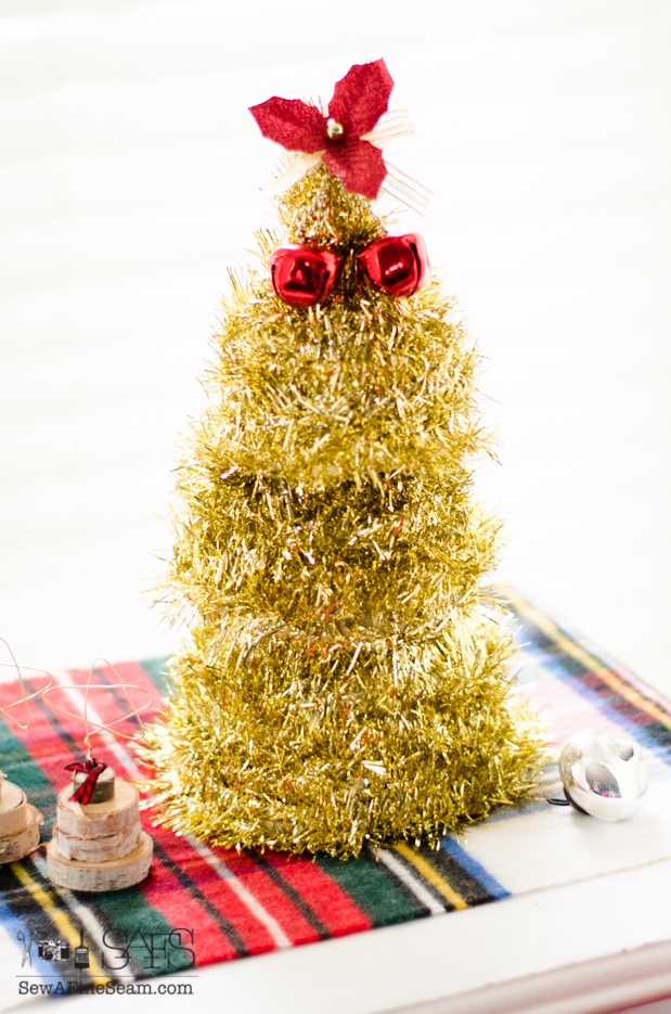 Christmas tree made from dollar store funnles, tinsel and decor