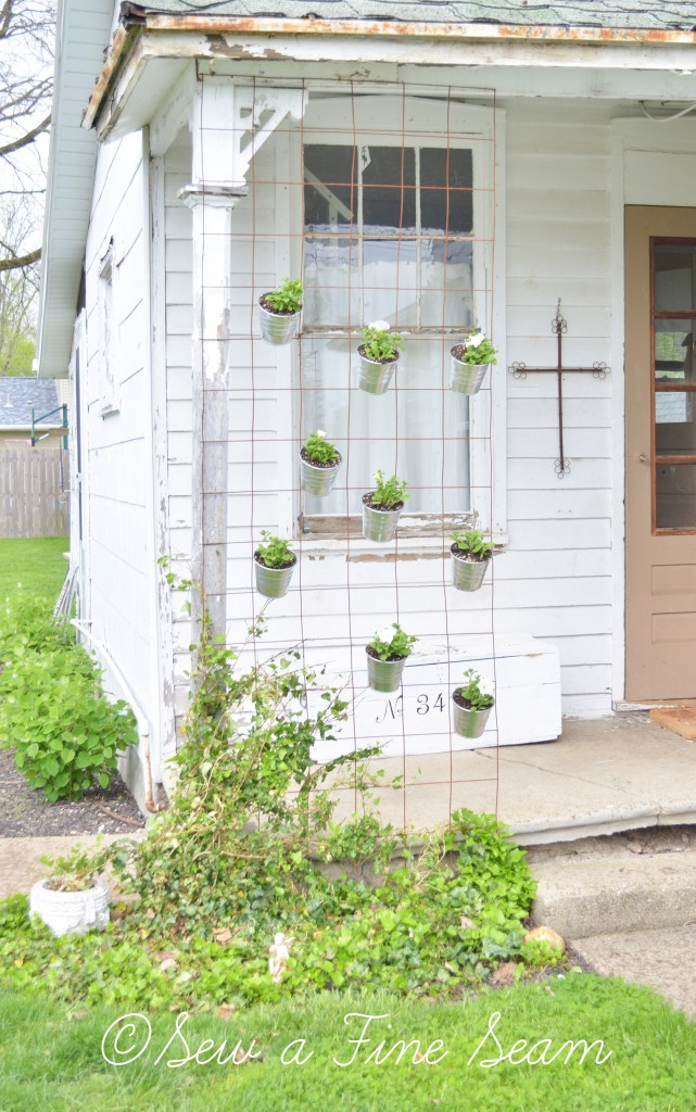 creating a hanging planter with rusty fencing and IKEA pots