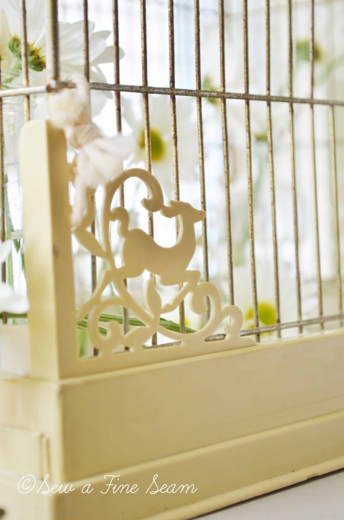 bird cage with daisys 6