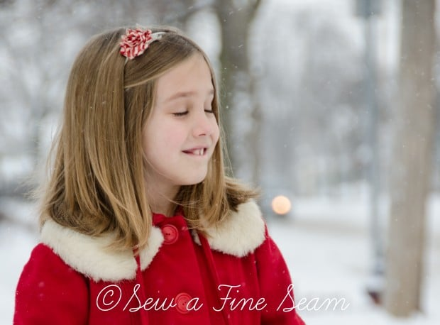 red coat in the snow-13