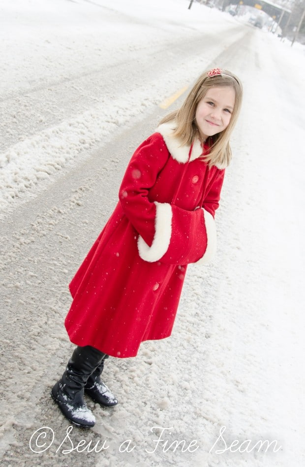 red coat in the snow-18