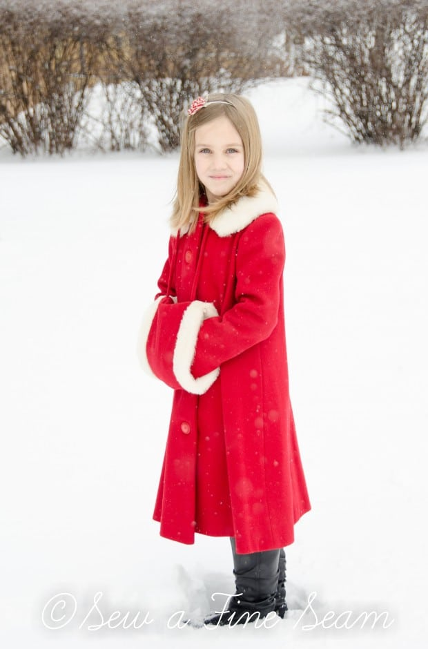 red coat in the snow-3
