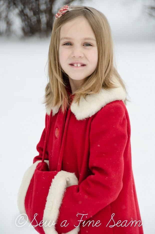 red coat in the snow-7