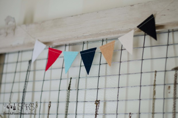 felt pennant to detail jewelry display