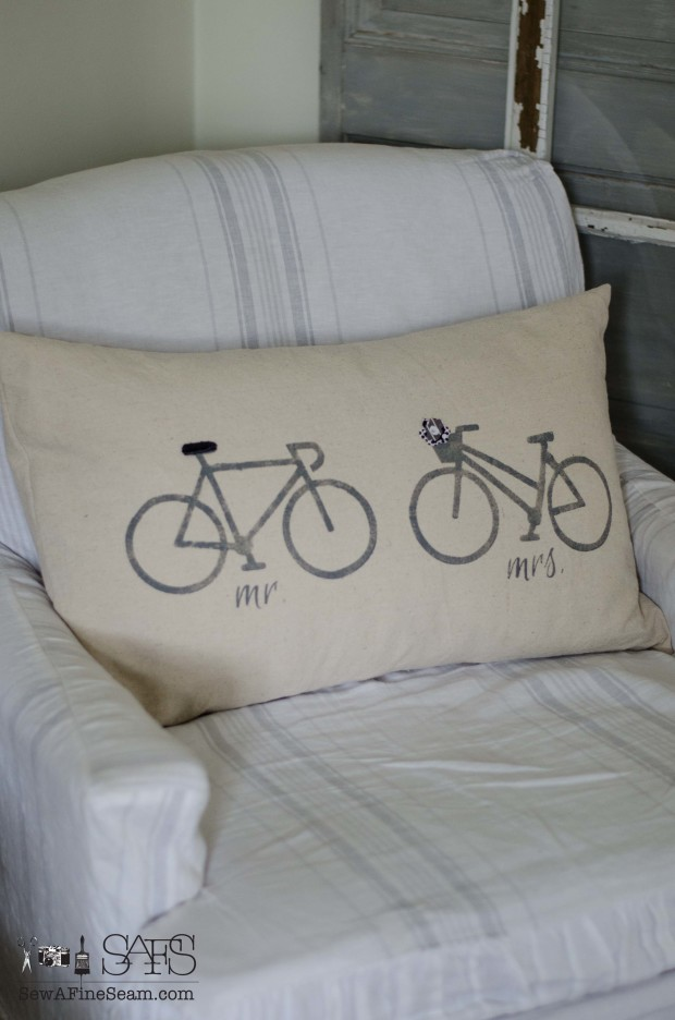mr and mrs pillow with his and hers bikes detailed with leather and a fabric flower