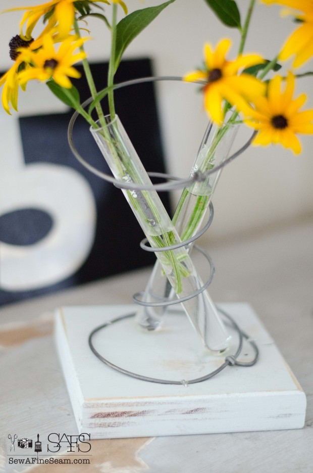 vase made with test tubes and an old bedspring