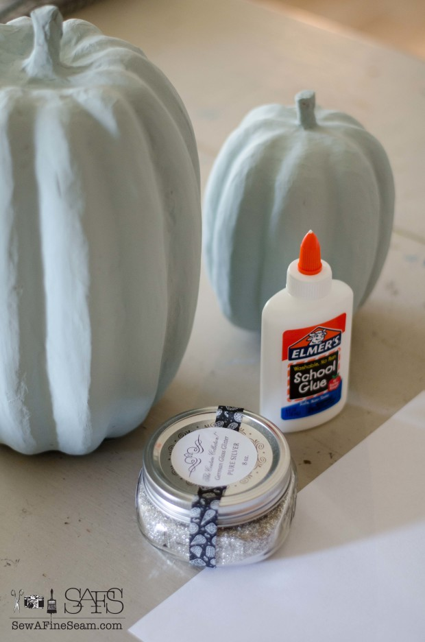 painting and glittering faux pumpkins
