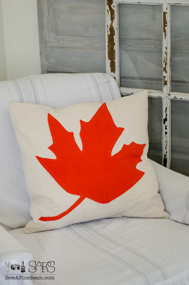 canvas pillow with large maple leaf in orange felt