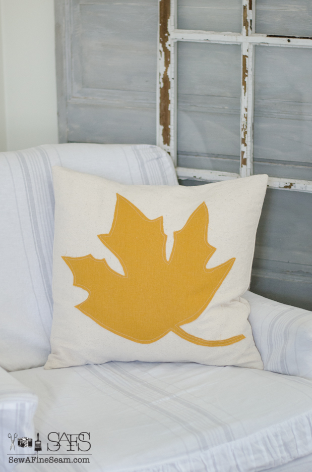 canvas pillow with large maple leaf in yellow linen