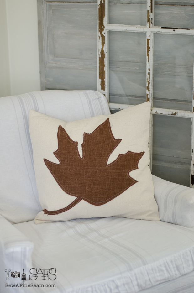 canvas pillow with large maple leaf in brown linen