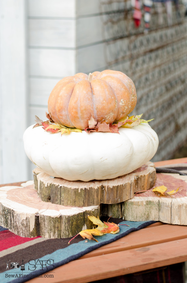 stack of pumpkins and leaves for a simple fall centerpiece
