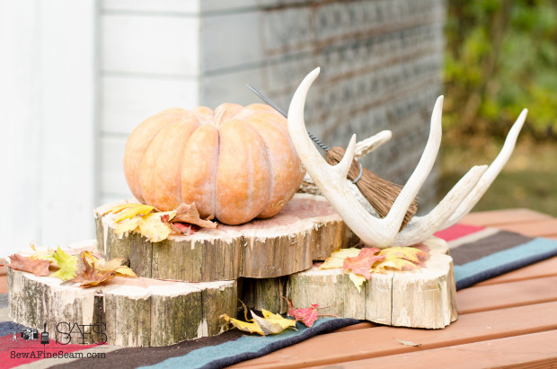 Natural elements like leaves and pumpkins for a fall centerpiece