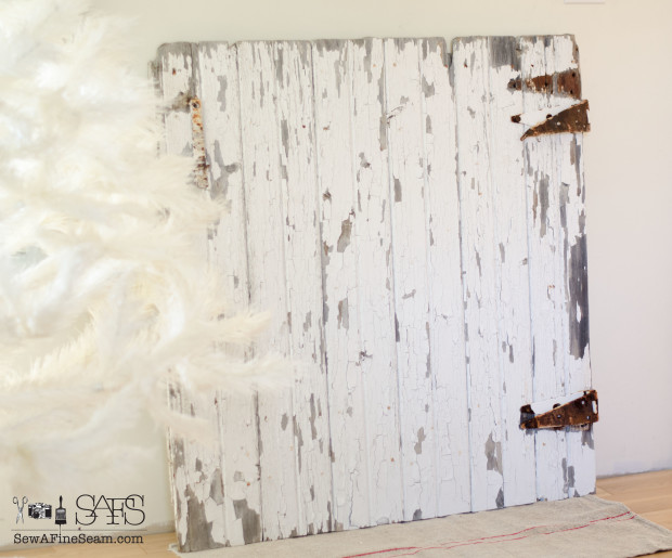 old barn door turns into a 'mantel' for christmas