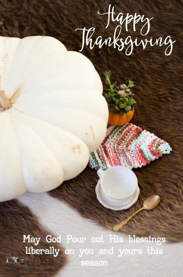 white pumpkin and knit fall leaf for thanksgiving