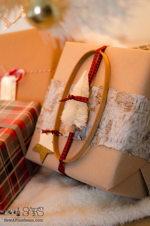 Christmas gift wrapped with unexpected elements - ribbon, birch bark, embroidery hoop, bottle brush tree